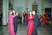 Washington, DC - (FILE) -- United States President Ronald Reagan and Prime Minister Margaret Thatcher of Great Britain share a dance in the Entrance Hall of the the White House in Washington, D.C. following the dinner in her honor on Wednesday, November 16, 1988.  At right their spouses, first lady Nancy Reagan and Denis Thatcher share a dance as well..Credit: Ron Sachs / CNP