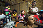 Youth participate in a class on hair styling, one of many skills training opportunities at the Brighter Future Children Rescue Center in Buchanan, Liberia. The center, supported by the United Methodist Church in Germany and United Methodist Women, carries out rehabilitation work with ex-combatants and other war-affected children.