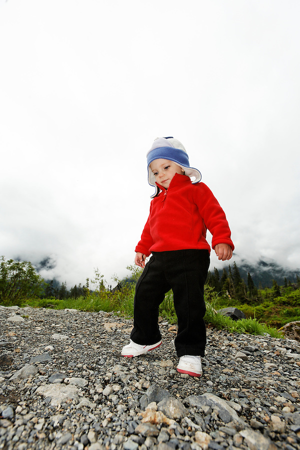 Young girl walking in mountainous boulder field, Big Four Trail, Mt Baker Snoqualmie National Forest, Washington, USA