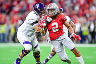 Indianapolis, IN - DEC 1, 2018: Ohio State Buckeyes defensive end Chase Young (2) rushes against Northwestern Wildcats offensive lineman Rashawn Slater (70) during game between Northwestern and Ohio State at Lucas Oil Stadium in Indianapolis, IN. Chase finished the game with 3 sacks as Ohio State defeats Northwestern 45-24. (Photo by Phillip Peters/Media Images International)