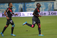 BOGOTA -COLOMBIA. 30-03-2014.  Edinson Toloza  de Atletico Junior celebra su gol contra  La Equidad partido por la treceava  fecha de La liga Postobon 1 disputado en el estadio Metropolitano de Techo . /    Edinson Toloza  of Atletico Junior   celebrates his goal   against La Equidad    of  thirteenth round during the match  of The Postobon one league  at the Metropolitano of Techo Stadium . Photo: VizzorImage/ Felipe Caicedo / Staff