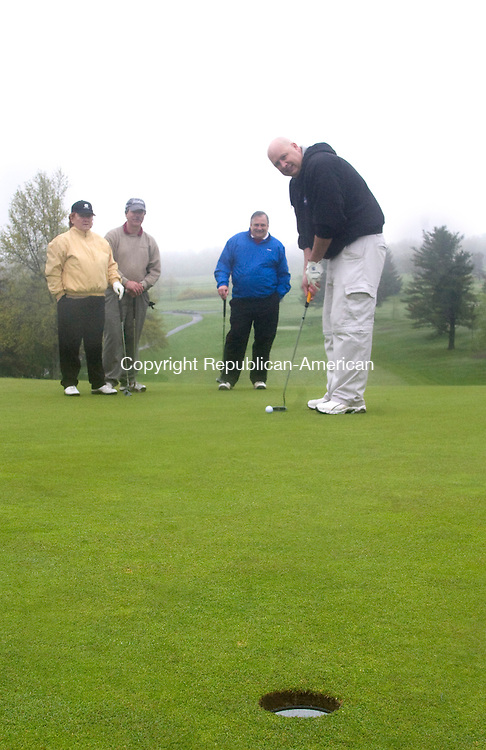 GOSHEN CT.-16 MAY  2011  051611DA01- The rain didn't stop employees of Alcoa Howmet in Winsted from coming out to golf during the United Way's 30th annual Golf Tournament held at the Torrington Country Club in Goshen on Monday.  From left, Betty Miller, Ted Benedict, John Spina and Paul Peck. <br /> Republican-American Darlene Douty
