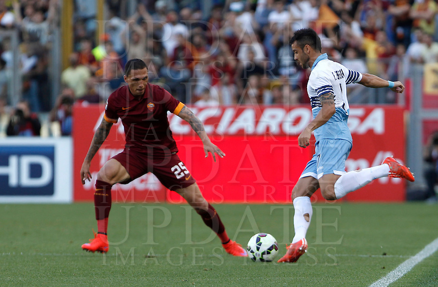 Calcio, Serie A: Lazio vs Roma. Roma, stadio Olimpico, 25 maggio 2015.<br /> Lazio&rsquo;s Felipe Anderson, right, is challenged by Roma&rsquo;s Jose&rsquo; Holebas during the Italian Serie A football match between Lazio and Roma at Rome's Olympic stadium, 25 May 2015.<br /> UPDATE IMAGES PRESS/Isabella Bonotto