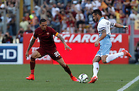 Calcio, Serie A: Lazio vs Roma. Roma, stadio Olimpico, 25 maggio 2015.<br /> Lazio's Felipe Anderson, right, is challenged by Roma's Jose' Holebas during the Italian Serie A football match between Lazio and Roma at Rome's Olympic stadium, 25 May 2015.<br /> UPDATE IMAGES PRESS/Isabella Bonotto