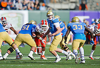 SAN FRANCISCO, CA - December 31, 2011: UCLA quarterback Kevin Prince (4) sees a fumble occur against University of Illinois at AT&T Park in San Francisco, California. Final score Illinois wins 20-14.