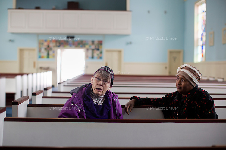 A caregiver and resident Marilyn Davidson (left) sit in the Chapel of the Holy Innocents at the Fernald Developmental Center in Waltham, Massachusetts, USA.
