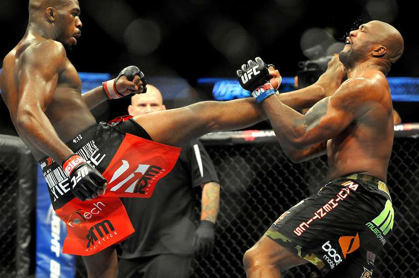 "24 SEPTEMBER 2011:   Jon ""Bones"" Jones lands a kick on the bloodied face of Quinton ""Rampage"" Jackson  during UFC 135 at the Pepsi Center in Denver, Colorado. *****For Editorial Use Only*****"