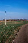 A912Y9 Telephone poles and wires crossing countryside Butley Suffolk England