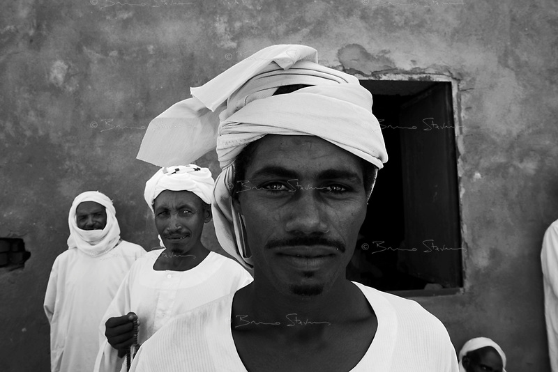 Mastariya, North Darfur, August 13, 2004.Saluz, (center), a Janjaweed after his Friday prayer. Men from this village are Arabs from the Rezeghat tribe, most of them are enlisted in Janjaweed militia after Musa Hillal, their Sheikh, gave full support to the Khartoum government allegedly to fight the SLA rebels.