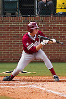 NASHVILLE, TENNESSEE-Feb. 27, 2011:  Stephen Piscotty of Stanford bunts during the game at Vanderbilt.  Stanford defeated Vanderbilt 5-2.