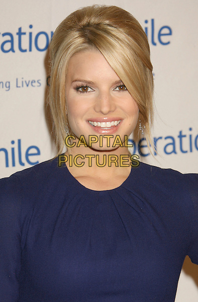 """JESSICA SIMPSON.25th Annual """"Operation Smile"""" Benefit Gala held at the Beverly Hills Hotel, Beverly Hills, California, USA, .5 October 2007..portrait headshot smiling.CAP/ADM/RE.©Russ Elliot/AdMedia/Capital Pictures."""