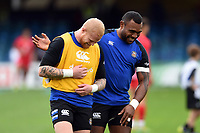 Tom Homer and Semesa Rokoduguni of Bath Rugby during the pre-match warm-up. Heineken Champions Cup match, between Bath Rugby and Stade Toulousain on October 13, 2018 at the Recreation Ground in Bath, England. Photo by: Patrick Khachfe / Onside Images
