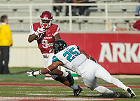 Hawgs Illustrated/BEN GOFF <br /> De'Vion Warren, Arkansas wide receiver, tries to break the tackle of Laqavious Paul, Coastal Carolina linebacker, after a catch in the second quarter Saturday, Nov. 4, 2017, at Reynolds Razorback Stadium in Fayetteville.