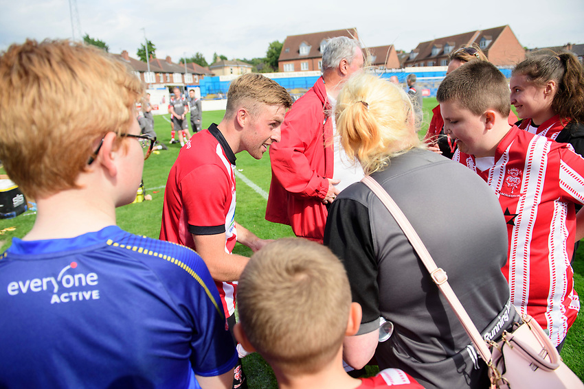Lincoln City's Joe Morrell signs autographs for fans<br /> <br /> Photographer Chris Vaughan/CameraSport<br /> <br /> Football Pre-Season Friendly (Community Festival of Lincolnshire) - Gainsborough Trinity v Lincoln City - Saturday 6th July 2019 - The Martin & Co Arena - Gainsborough<br /> <br /> World Copyright © 2018 CameraSport. All rights reserved. 43 Linden Ave. Countesthorpe. Leicester. England. LE8 5PG - Tel: +44 (0) 116 277 4147 - admin@camerasport.com - www.camerasport.com