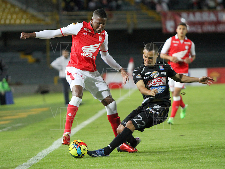 BOGOTA -COLOMBIA- 6 -10--2013.William Zapata (Izq) de Independiente Santa Fe disputa el balon contra Sebastian Puerta  (Der)  de Once Caldas, partido correspondiente a la catorceava  fecha de La Liga Postobon segundo semestre jugado en el estadio El Campin / XXXXXX (L) of Independiente Santa Fe dispute the ball against XXXXXX (Der) of Once Caldas, the fourteenth game in La Liga Postobon date second half played at El Campin.Photo: VizzorImage / Felipe Caicedo / Staff