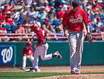 9 March 2014: St. Louis Cardinals pitcher Joe Kelly looks down as Anthony Rendon rounds third after hitting a solo home run in the first inning of a Spring Training game against the Washington Nationals at Space Coast Stadium in Viera, Florida. The Nationals defeated the Cardinals 11-1 in Grapefruit League play. Mandatory Credit: Ed Wolfstein Photo *** RAW (NEF) Image File Available ***