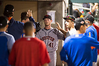 Scottsdale Scorpions relief pitcher J.B. Bukauskas (41), of the Houston Astros organization, is congratulated by his teammates in the dugout after his outing in an Arizona Fall League game against the Salt River Rafters at Salt River Fields at Talking Stick on October 11, 2018 in Scottsdale, Arizona. Salt River defeated Scottsdale 7-6. (Zachary Lucy/Four Seam Images)