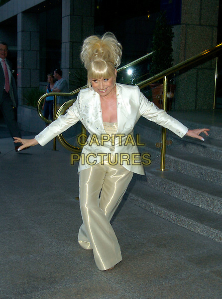 BARBARA WINDSOR.Attending her 70th Birthday Party, .Royal Garden Hotel, London, England, August 5th 2007..full  length steps gold trousers white jacket suit cream satin silk shiny arms curtsey curtsy funny.CAP/CAN.©Can Nguyen/Capital Pictures