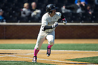 Nate Mondou (10) of the Wake Forest Demon Deacons hustles down the first base line against the Virginia Tech Hokies at Wake Forest Baseball Park on March 7, 2015 in Winston-Salem, North Carolina.  The Hokies defeated the Demon Deacons 12-7 in game one of a double-header.   (Brian Westerholt/Four Seam Images)