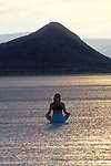 Woman meditating on the playa in the Black Rock Desert