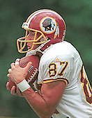 Washington Redskin wide receiver James Thrash hugs the football as he fields a kickoff during practice drills at Redskins training camp at Redskin Park in Ashburn, Virginia on July 30, 2000. Thrash is expected to take up the kickoff return duties assigned to Brian Mitchell before he was released. <br /> Credit: Arnie Sachs / CNP