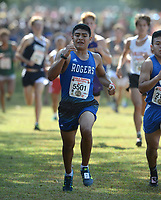 NWA Democrat-Gazette/ANDY SHUPE<br /> Rogers' Josh Zuniga nears the finish line Saturday, Oct. 5, 2019, during the Chile Pepper Cross Country Festival at Agri Park in Fayetteville. Visit nwadg.com/photos to see more photographs from the races.