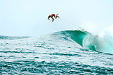 INDONESIA, Mentawai Islands, Kandui Resort, surfer diving over the back of a wave, Bankvaults