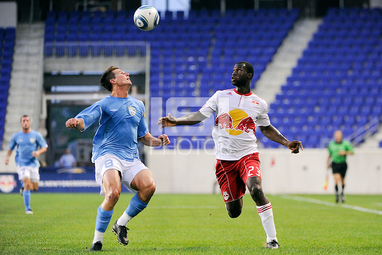 Troy Cole (8) of FC New York and Mike Jones (23) of the New York Red Bulls. The New York Red Bulls defeated FC New York 2-1 during a third round match of the 2011 Lamar Hunt US Open Cup at Red Bull Arena in Harrison, NJ, on June 28, 2011.