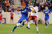 Davy Arnaud (22) of the Kansas City Wizards  and Tony Tchani (23) of the New York Red Bulls battle for the ball. The New York Red Bulls defeated the Kansas City Wizards 1-0 during a Major League Soccer (MLS) match at Red Bull Arena in Harrison, NJ, on October 02, 2010.