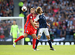 Scotland's Stuart Armstrong tuslses with England's Eric Dier during the FIFA World Cup Qualifying match at Hampden Park Stadium, Glasgow Picture date 10th June 2017. Picture credit should read: David Klein/Sportimage