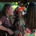 Closeup of Ellie Buckland singing withThe Lula Wiles Group (Isa Burke, Ellie Buckland, and Mali Obomsawin, performing on the Hoot Hill stage, on the 2nd day of the 4th Annual Summer Hoot Festival held at the Ashokan Center, Olivebridge, NY, on Saturday, August 27, 2016. Photo by Jim Peppler; Copyright Jim Peppler 2016.