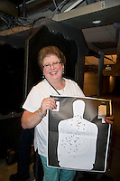 Lorton,VA, July 10 2016, USA--Rita Mayer, a transgender woman, holds up her target at a gun range in Lorton, VA.  Members of the Pink Pistols, a Lesbian,Gay, Bi-sexual, Transgender (LGBT) gun club, gather at a shooting range to practice their skills.  The Pink Pistols advocate the rights of all LGBT people to own guns.  Patsy Lynch/MediaPunch