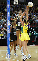 Silver Ferns Anna Scarlett looks to block the shot of   Australian Sharelle McMahon during the netball test match between the Silver Ferns v Australia played at the Sydney Superdome, Sydney Australia, 29th June 2005. The Silver Ferns won 50-43. ©Michael Bradley