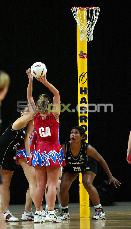 Pix: Simon Wilkinson/SWpix.com. International Netball. England v New Zealand. Test Series 2003. MEN Arena. Manchester. 24/02/03..COPYRIGHT PICTURE>>SIMON WILKINSON>>01943 436649>>..England's Tarcey Neville has a shot on goal