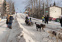 Scott Janssen and team run past spectators on the bike/ski trail with an Iditarider in the basket during the Anchorage, Alaska ceremonial start on Saturday, March 5, 2016 Iditarod Race. Photo by O'Hara Shipe/SchultzPhoto.com