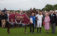 Best Playing Pony on display with Fecund Pieres (King Power Foxes) Her Majesty the Queen and Arnaud M. Bamberger, Executive Chairman (right) during the Cartier Queens Cup Final match between King Power Foxes and Dubai Polo Team at the Guards Polo Club, Smith's Lawn, Windsor, England on 14 June 2015. Photo by Andy Rowland.
