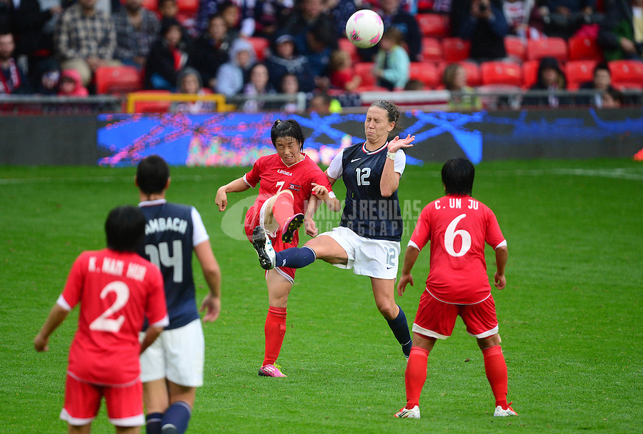 Jul 31, 2012; Manchester , United Kingdom; USA forward Lauren Cheney (12) battles for the ball against North Korea forward Gyong Ri Ye in the second half during the women's preliminary round in the London 2012 Olympic Games at Old Trafford. USA defeated North Korea 1-0. Mandatory Credit: Mark J. Rebilas-USA TODAY Sports