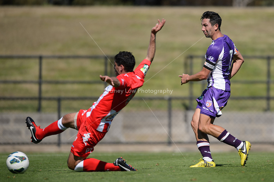 MELBOURNE - 22 September: Jacob BURNS of the Glory kicks a goal at a pre-season match between Melbourne Heart and Perth Glory at Epping Stadium on 22 September 2012. (Photo by Sydney Low / syd-low.com)
