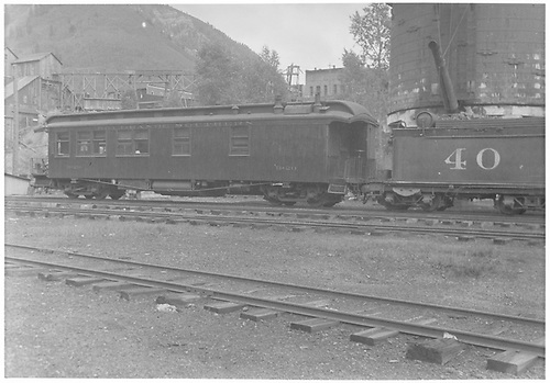 An east-facing partial view of the RGS #40's tender stopped southbound at the Rico water tank with business car #B-20.<br /> RGS  Rico, CO  Taken by Barriger, John W. III - 9/9/1935