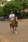 Chile, Easter Island: Man riding horse..Photo #: ch321-32986.Photo copyright Lee Foster www.fostertravel.com lee@fostertravel.com 510-549-2202