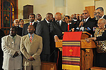 Ministers and the Congressman Bobby Rush (right of microphone) call for beleaguered Illinois Governor Rod Blagojevich's pick for Barack Obama's U.S. Senate seat, Roland Burris, to be allowed to take his respective seat in the U.S. Senate without problem ahead of a prayer send-off prior to Burris' departure to Washington at the New Covenant Baptist Church on the South Side of Chicago, Illinois on January 4, 2008.