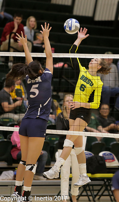 SPEARFISH, SD: SEPTEMBER 29:  Sierra Stugelmeyer #6 of Black Hills State hits toward Lindsey Jin #5 of Colorado Mines during their college volleyball match Friday at the Donald E. Young Center in Spearfish, S.D.   (Photo by Dick Carlson/Inertia)