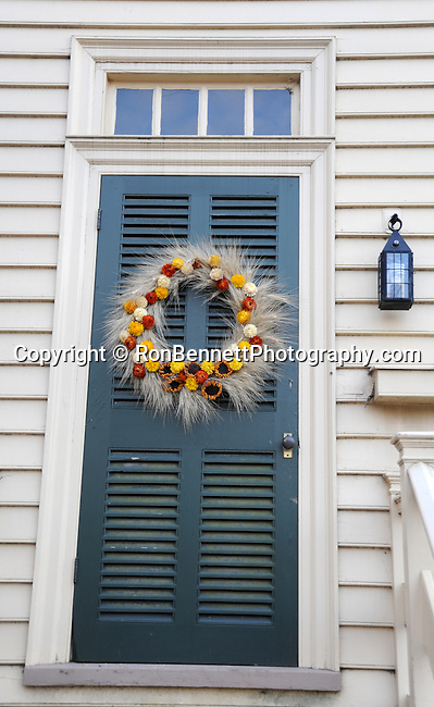"Door and Christmas wreath Colonial Williamsburg Virginia, Colonial Williamsburg Virginia is historic district 1699 to 1780 which made colonial Virgnia's Capital, for most of the 18th century Williamsburg was the center of government education and culture in Colony of Virginia, George Washington, Thomas Jefferson, Patrick Henry, James Monroe, James Madison, George Wythe, Peyton Randolph, and others molded democracy in the Commonwealth of Virginia and the United States, Motto of Colonial Williamsburg is ""The furture may learn from the past,"""