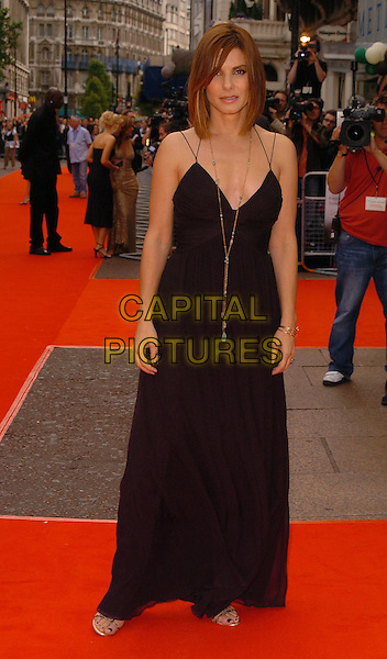 "SANDRA BULLOCK.At the UK Premiere of ""The Lake House"",.Vue West End, London, England, June 19th 2006..full length long black dress gold necklace.Ref: CAN.www.capitalpictures.com.sales@capitalpictures.com.©Can Nguyen/Capital Pictures"