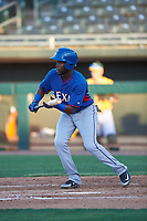 AZL Rangers Rafy Barete (21) bunts during an Arizona League game against the AZL Athletics Gold on July 15, 2019 at Hohokam Stadium in Mesa, Arizona. The AZL Athletics Gold defeated the AZL Rangers 9-8 in 11 innings. (Zachary Lucy/Four Seam Images)