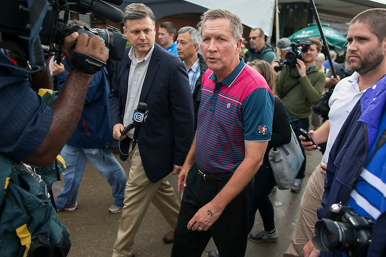 UNITED STATES - August 17: Republican presidential candidate and Ohio Governor John Kasich walks through the concourse at the Iowa State Fair on Tuesday, August 18, 2015 in Des Moines, Iowa. (Photo By Al Drago/CQ Roll Call)