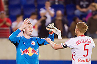 New York Red Bulls goalkeeper Ryan Meara (18) celebrates with Markus Holgersson (5) after the game. The New York Red Bulls defeated the Houston Dynamo 1-0 during a Major League Soccer (MLS) match at Red Bull Arena in Harrison, NJ, on May 09, 2012.