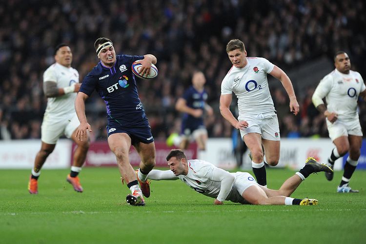 Stuart McInally (c) of Scotland breaks the tackle of Jonny May of England to run in for a try during the Guinness Six Nations Calcutta Cup match between England and Scotland at Twickenham Stadium on Saturday 16th March 2019 (Photo by Rob Munro/Stewart Communications)