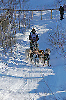 Saturday, February 24th, Knik, Alaska.  Jr. Iditarod musher Kristen Crain on the trail shortly after leaving the Knik start