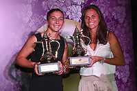 SINGAPORE - OCTOBER 25:   Roberta Vinci and Sara Errani of Italy who hold their WTA Year End World Number One Doubles Team Trophies sponsored by Dubai Duty Free at the WTA Year End Gala Party at the Marina Bay Sands Hotel during the BNP Paribas WTA Finals at Singapore Sports Hub on October 25, 2014 in Singapore.  (Photo by Clive Brunskill/Getty Images)